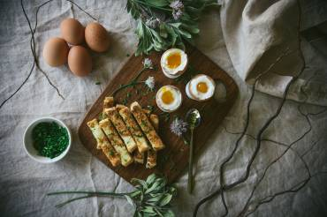Dippy eggs with Parmesan & chive soldiers